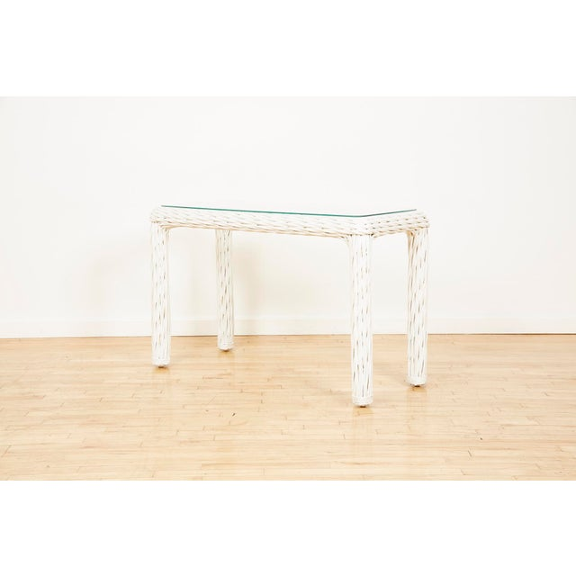 Vintage rectangular sofa or console table with thick white wicker frame and clear glass top from the 1980s.