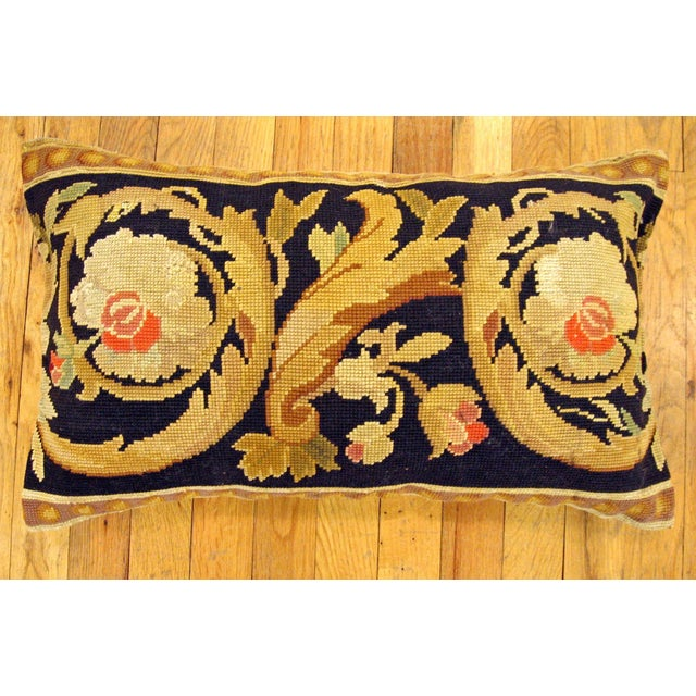 "A decorative antique French Needlepoint carpet pillow, size 20"" x 14"" (1'8"" x 1'2""), fronted by a segment of an antique..."