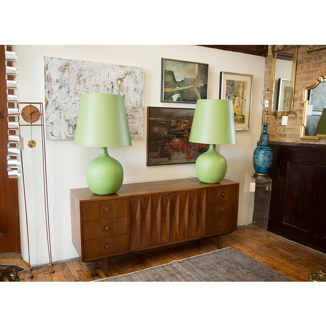 A gorgeous Mid-Century Dresser by American of Martinsville in walnut. A more uncommon design featuring a diamond front...