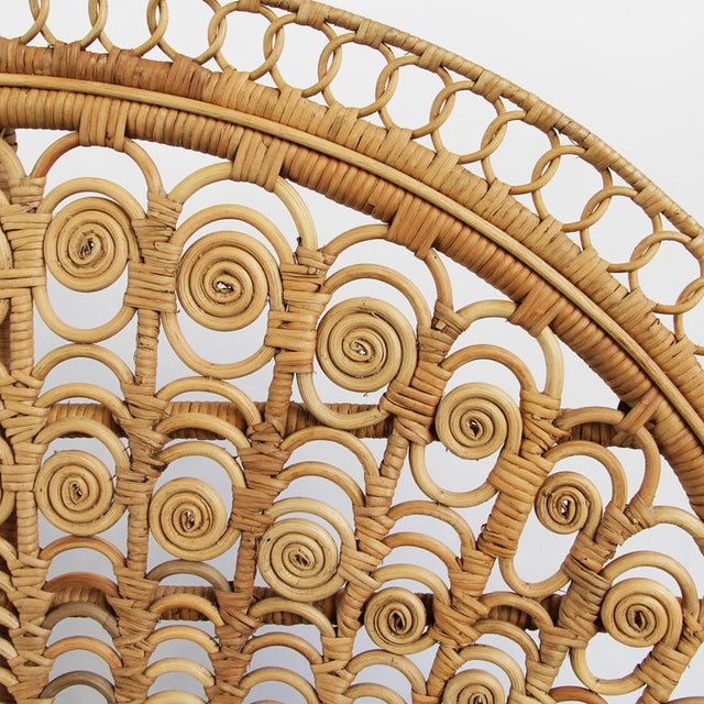 Fancy raw wicker peacock fan chair. Beautiful details and workmanship. This chair works great indoors or outdoors.
