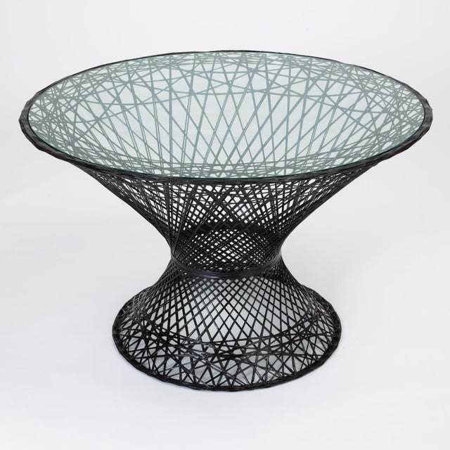 A dining table by Russell Woodard for his family company's popular line of spun fiberglass patio furniture. The design...