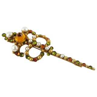 French Designer Henry Perichon Extra Long Gilt Bronze and Stones Pin Brooch For Sale