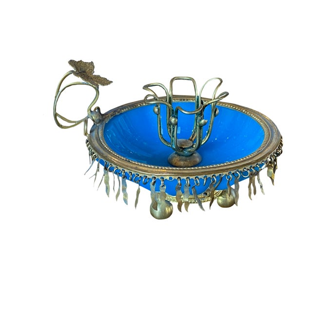 An antique French blue opaline candle holder with fringe gilt.