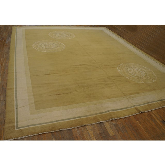 Antique Chinese Art Deco Rug with a yellow background and patterned border.
