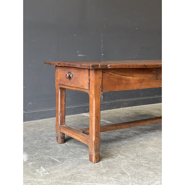 This is truly a stunning piece. Excellent construction, features four pull out drawers, beautiful patina to the wood.