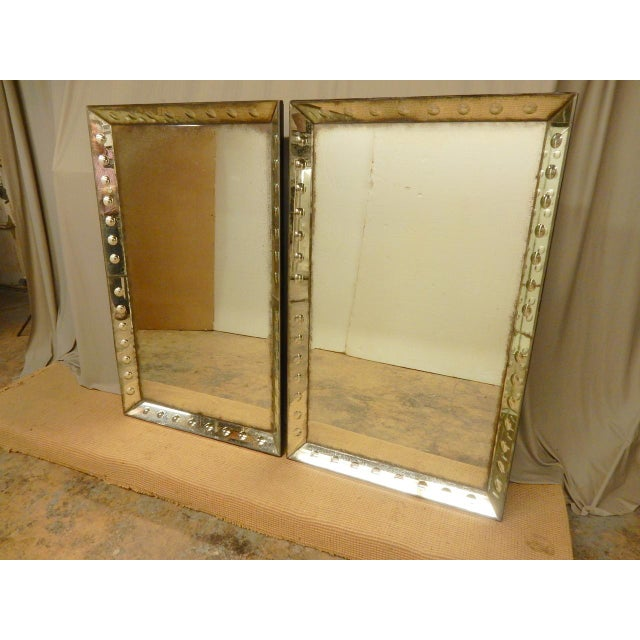 Pair of bubble glass mirror framed mirrors.