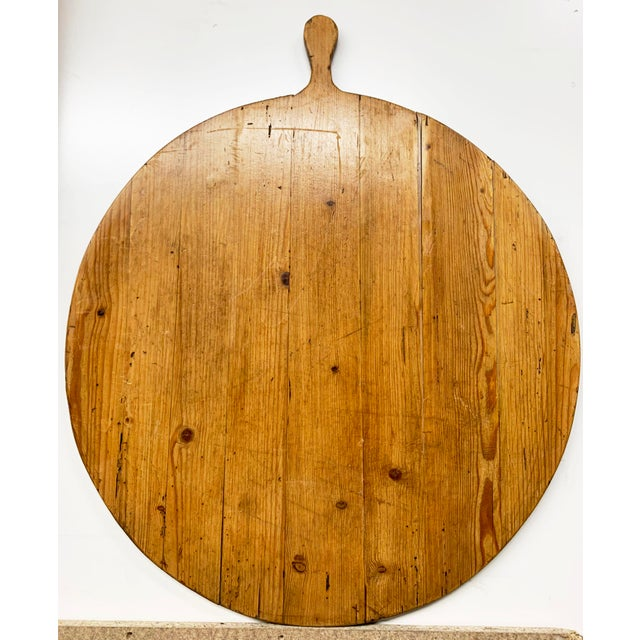 Beautiful Antique large round French Breadboard in a stunning honey pine golden color. This board has wonderful signs of...