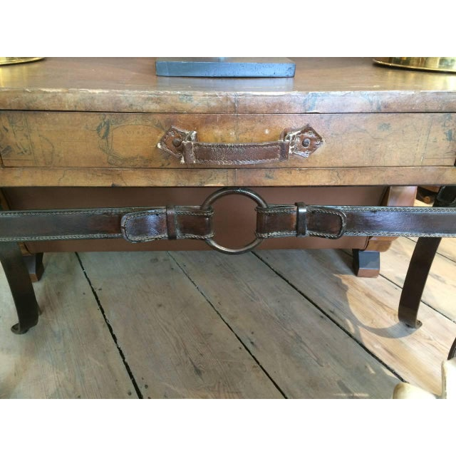 """This is a great find. A """"suitcase' tabletop depicting a world map on top, with leather straps and buckles and the leather..."""