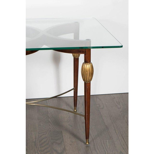 A stylish Mid-Century Modern Italian cocktail table in the style of Gio Ponti in mahogany and holly inlay with 24-carat...