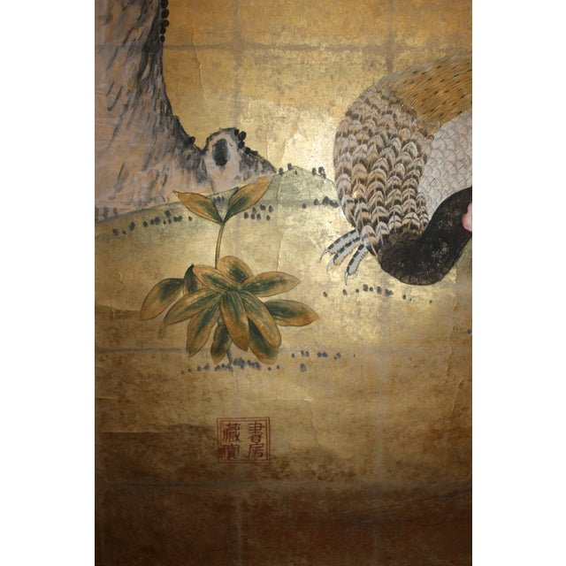 One peacock and an extended blossoming branch on a hill overlook nature in this breathtaking depiction of a transient...