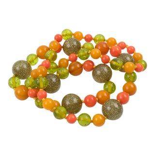 Bakelite & Lucite Necklace Extra Long Shape Orange Green & Glitter Beads For Sale