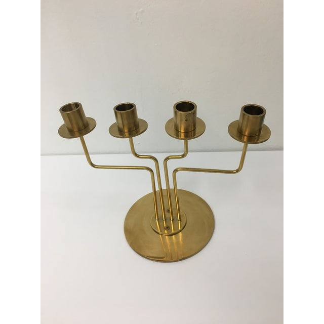 Elegant 1960s-style brass candelabra with classic mid-century modern shapes and details. In the manner of Gunnar Andersen....