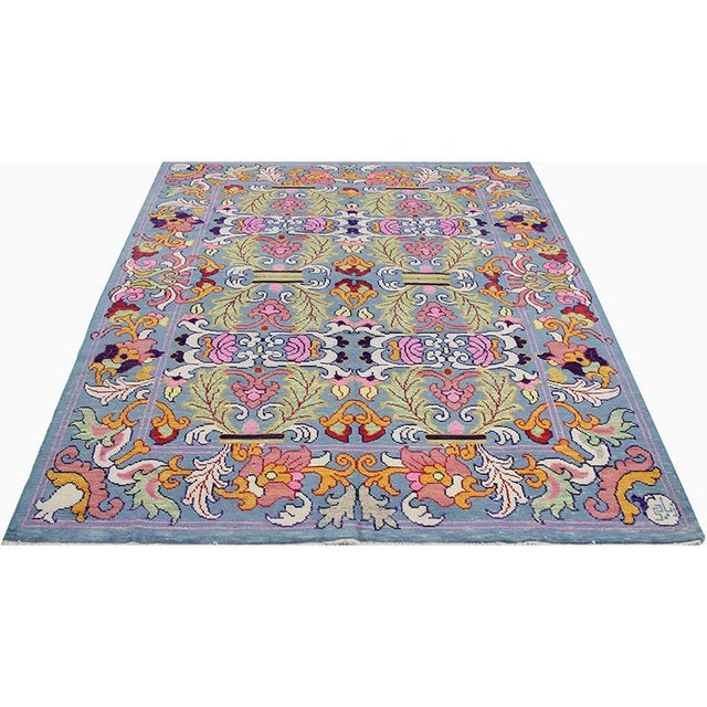 Traditional handwoven Sultanabad rug recreation featuring an all-over design of palmettes and flowerheads intertwined with...