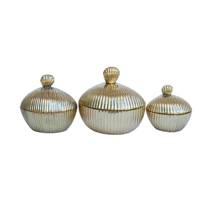 A matching set of three brass trinket boxes shaped like apples. Cast with gracious curves and a richly beveled surface...