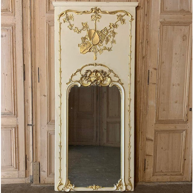 19th Century French Louis XVI Painted Trumeau features classically inspired architecture, and elaborate bas relief and...