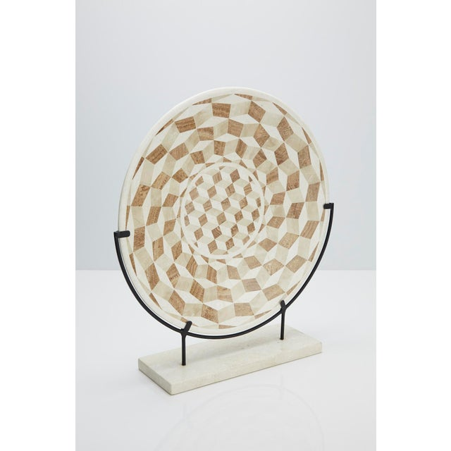 Decorative 19 in. diameter plate inlaid with white ivory stone, woodstone, beige fossil stone. Iron display stand included.