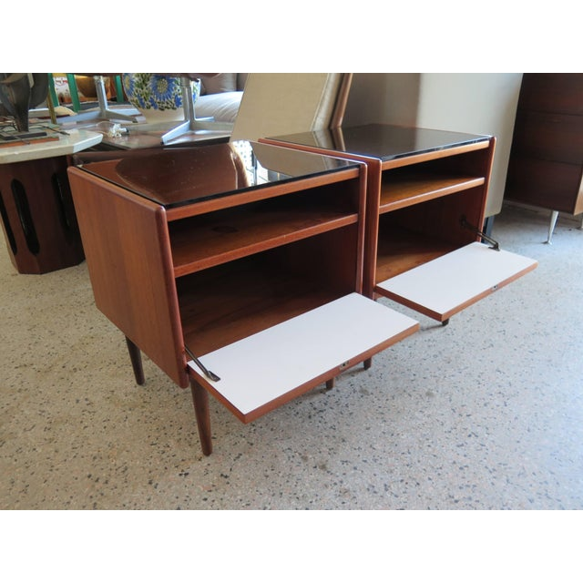 A pair of Classic night stands by Borge Mogensen for Soborg Mobler, Denmark, circa 1960s. Teak with white laminate drop...