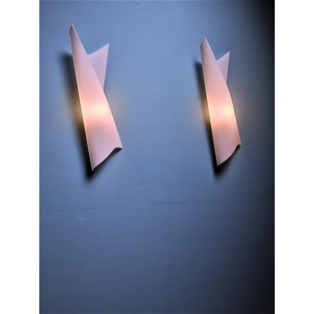 A pair of large Swedish wall lamps by Bertil Brisborg for Nordiska Kompaniet. The lamps are made of white plexiglass in a...