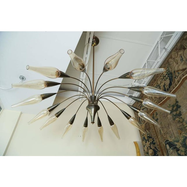One of a kind 1950s French chandelier with 16 arms and covered with original hand blown shades. The height is adjustable...