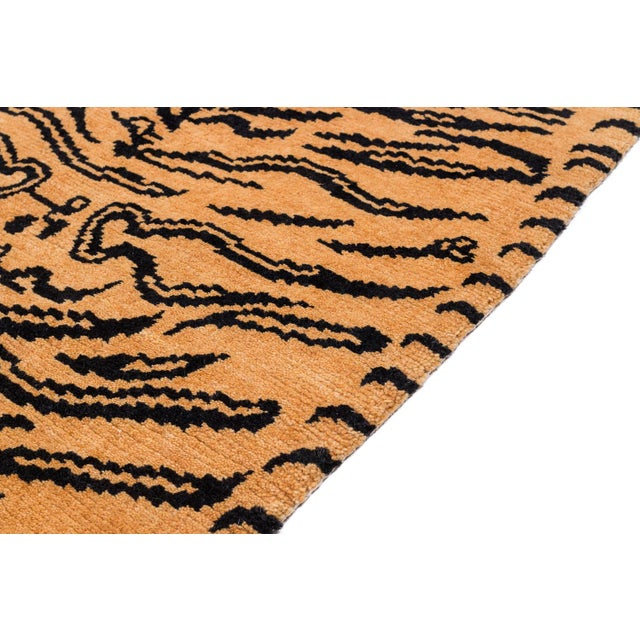 This tiger carpet is a fresh take on an original Joseph Carini design. It has a textured weave - a Devi weave, 60 knot. It...