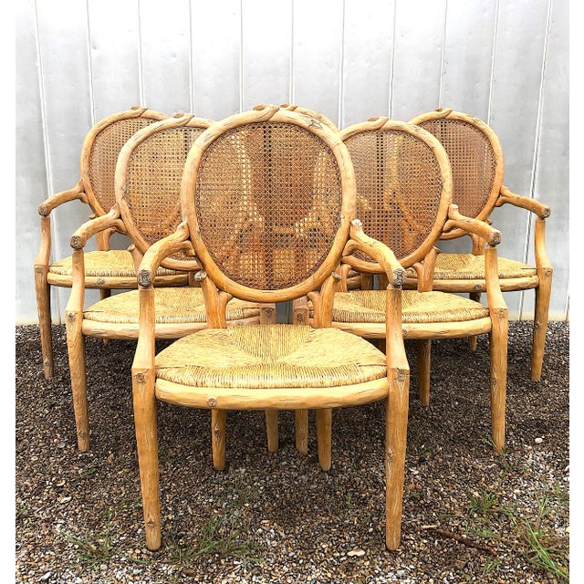 Beyond charming, this set of six Louis XVI armchairs with hand carved faux bois oak frames feature oval cane backs and...