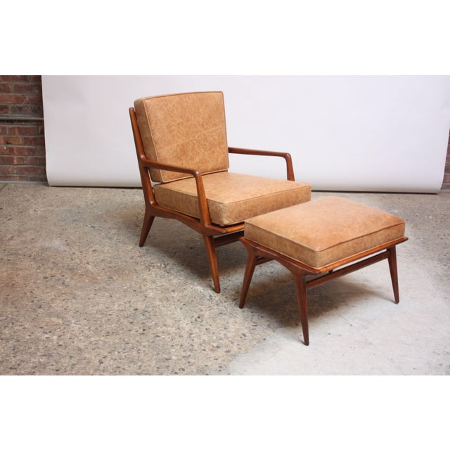 1950s Italian walnut lounge chair and ottoman designed by Carlo de Carli for M. Singer & Sons. Features a highly sculpted,...