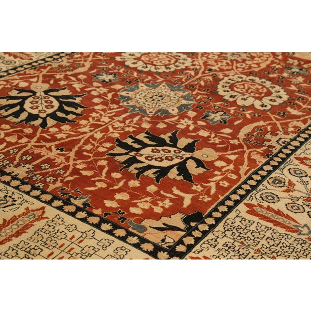 Turkish rug made from the best quality of wool and vegetable dyes. It features a spectacular floral center field in red...