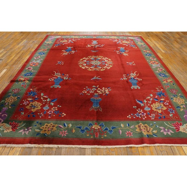 """This is a Chinese art wool rug from China 1920. The size is 9'x11'9"""". The colors are red, green, blue, purple, pink, tan,..."""