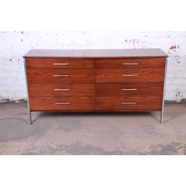 An exceptional mid-century modern long dresser or credenza designed by Paul McCobb for Calvin Furniture. The dresser...