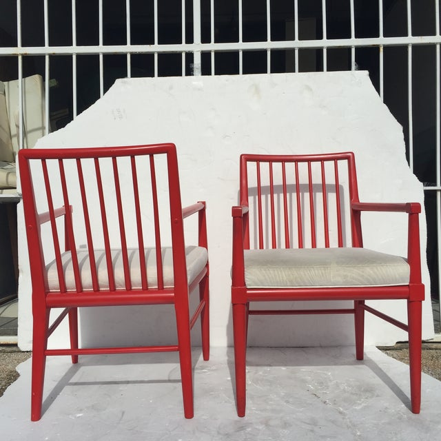 A pair of Robsjohn-Gibbings style armchairs. Classically designed yet modern. The red color adds a bit of glamour and...